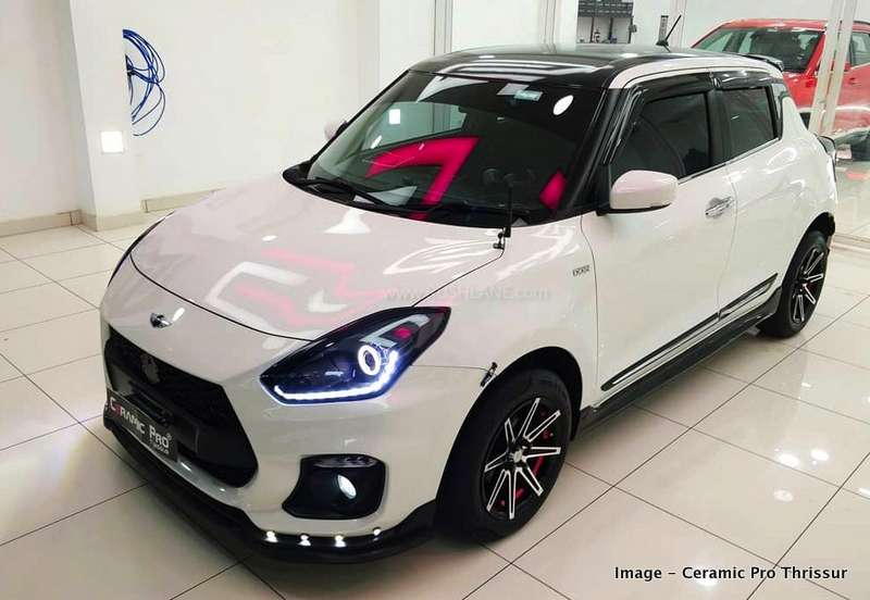 Maruti Swift modified with sport body kit and dual tone