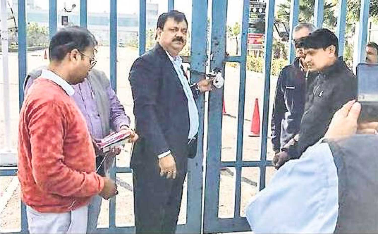 Officials sealing the main gate of Buddh International Circuit on Friday.