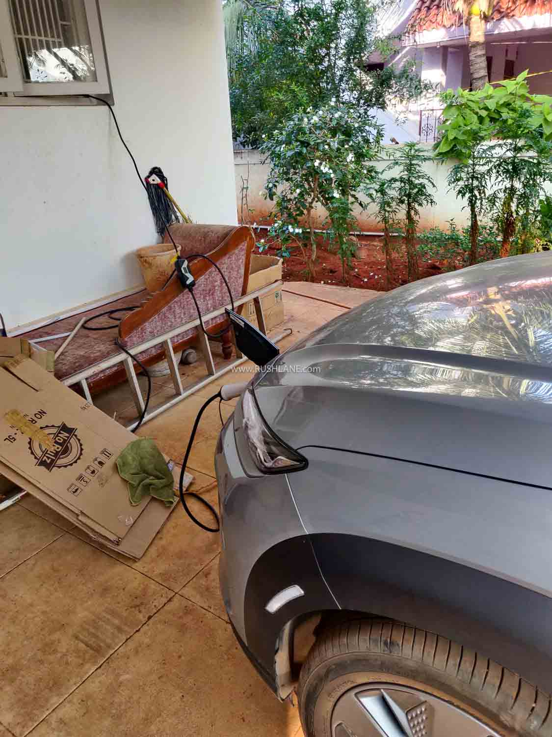 Hyundai Kona EV getting charged at Coimbatore using a regular socket.