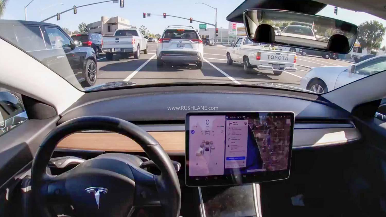 Tesla stops at traffic signal