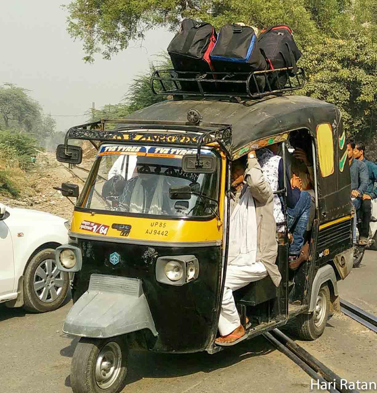 Rickshaw driver carrying migrants