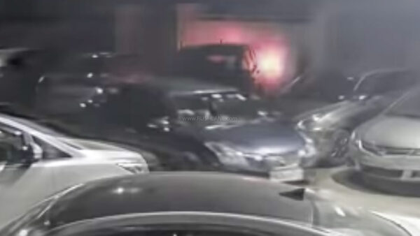 Thieves in Maruti Baleno, stealing the Toyota Innova parked behind